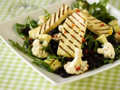 grilled halloumi cheese with rucola salad, black beans and avocado