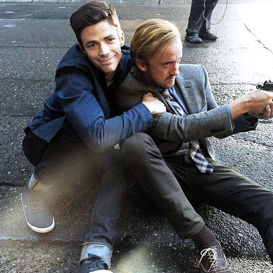 Can we just take a moment here, because there is Draco Malfoy with a muggle that has his arms around him.