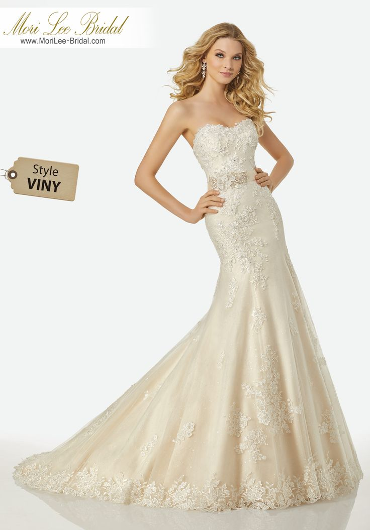 Style VINY KATHRYN WEDDING DRESSStrapless Fit and Flare Tulle Gown with Asymmetrical Beaded Lace Appliqués Over Sparkle Tulle and Three-Dimensional Floral Beaded Satin Sash at Waistline.Colors: IVORY, IVORY/GOLD