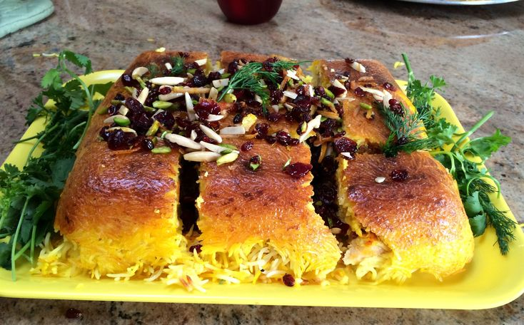 <p>My aunt Giti Joon is a master of the baked Persian rice dish, Tacheen. Her tacheen is rich with saffron, jeweled with dried berries, pistachios, and candied orange peel, and crusted with a thick and golden tadeeg crust that makes everyone's mouth water! It's her signature dish and I am …</p>