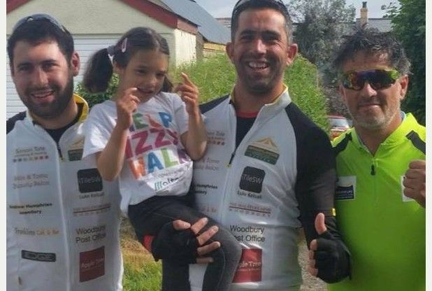 East Devon father cycles 962 miles to help give Izzy, 6, a chance to walk