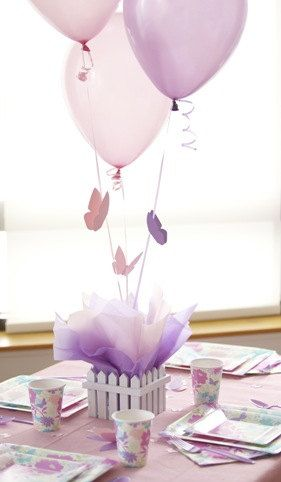Make your little girl smile at her next birthday party with butterfly-themed decorations like this simple centerpiece idea complete with lavender and pink balloons.