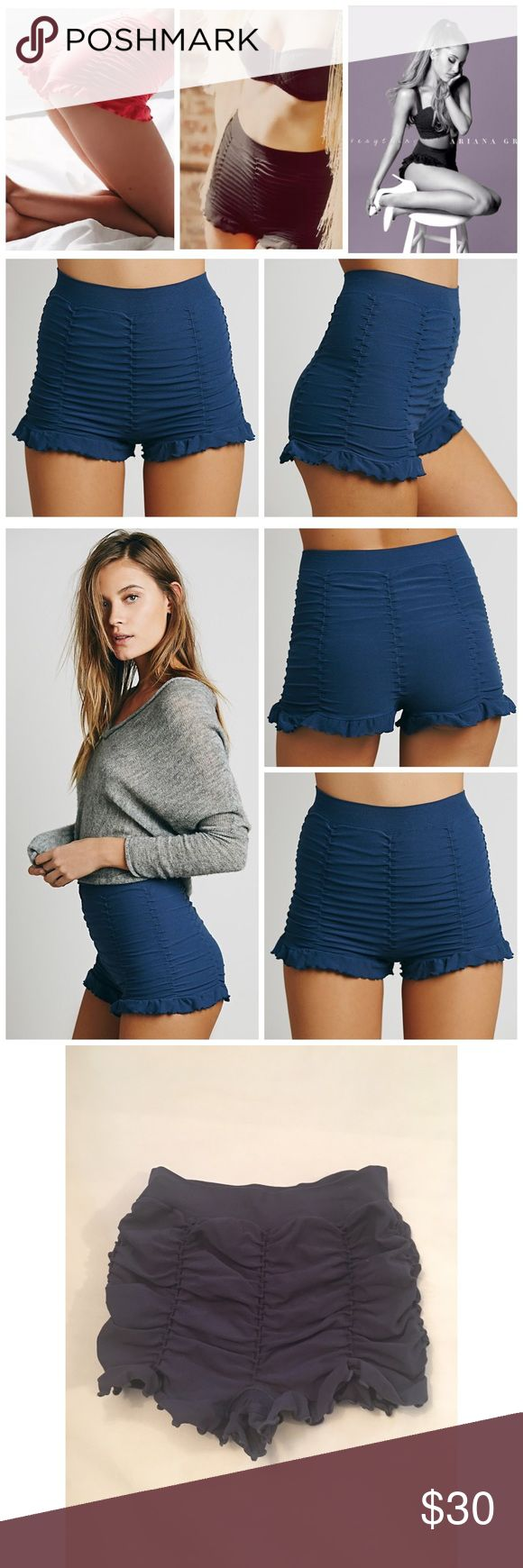 """INTIMATELY RUCHED SEAMLESS SHORTS NAVY FREE PEOPLE INTIMATELY RUCHED SEAMLESS SHORTS by FREE PEOPLE Color: NAVY BLUE only other colors shown for style reference. NAVY blue is sold out online! $38 retail. New without the tag inner label marked perfect condition   Stretchy seamless boy shorts with vertical ruched detailing all around with ruffles around bottom opening.  Intimately  92% Nylon 8% Spandex Hand Wash Cold Made in the USA size XS/S Waist all around - relaxed: 20.0"""" = 50.8 cm Rise…"""