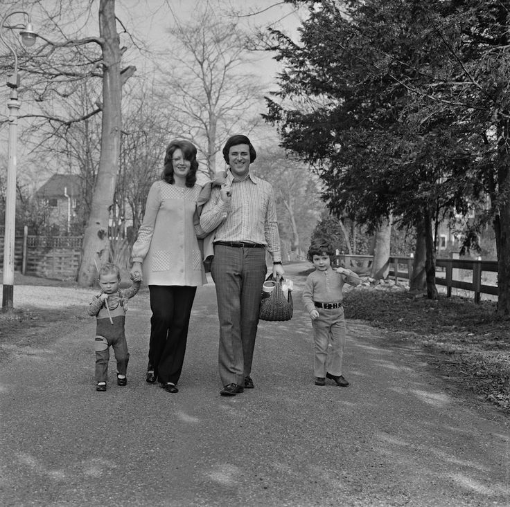 Terry Wogan takes a walk beside the River Thames with his wife, Helen Joyce, and their children Alan and Mark, 17th March 1972