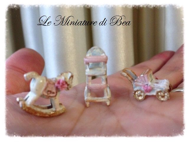1:48 Baby high chair, baby carriage, toy horse - miniature - dolls house - hand decorated - shabby chic by LeMiniaturediBea on Etsy https://www.etsy.com/listing/168747920/148-baby-high-chair-baby-carriage-toy