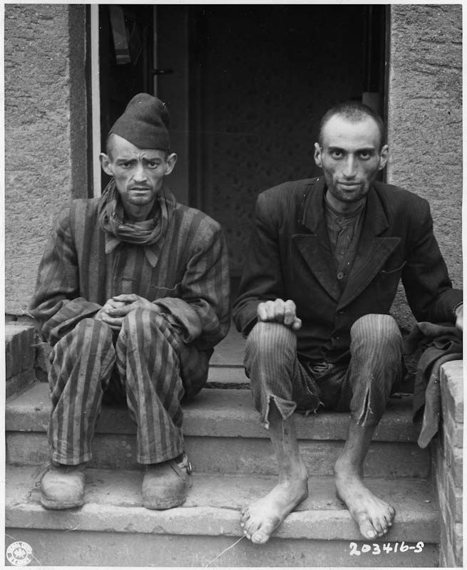 These two staring, emaciated men are liberated inmates of Lager-Nordhausen, a Gestapo concentration camp near Nordhausen, Germany