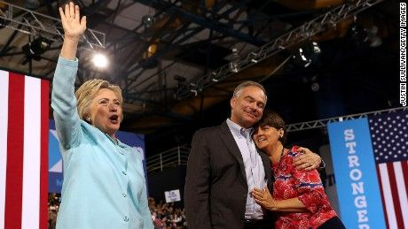 Hillary Clinton (L) greets suporters as democratic vice presidential candidate U.S. Sen. Tim Kaine (D-VA) hugs his wife Anne Holton during…
