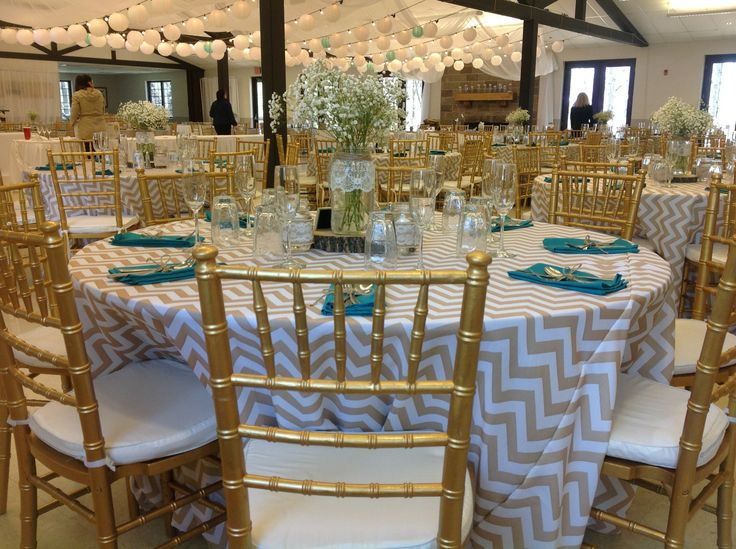 Palace Events: Lanterns, draping, round tables, chevron tablecloths, gold chiavari chairs