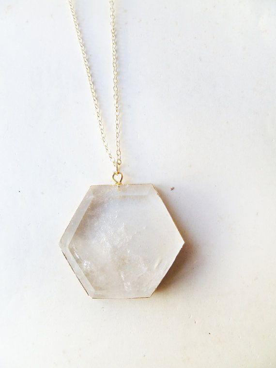 Natural quartz pendant edged in gold
