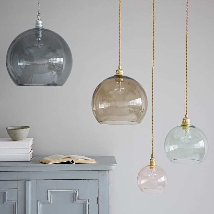 These beautiful mouthblown coloured glass pendant lights look stunning alone or mixed and matched. All four sizes are available in all colours shown. Available to order with a 6 week lead time. - Lightbulbs not included. All lamps take standard screw (E27) bulbs with the exception of the petite which takes a small screw (E14) bulb. - Wire colour is dependent on glass colour and is 2m long. - Smokey grey pendent always comes with a silver grey cord and silver cone fitting with a...