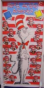 Dr. Seuss Board..pictures of the kids faces are under their hats...cute