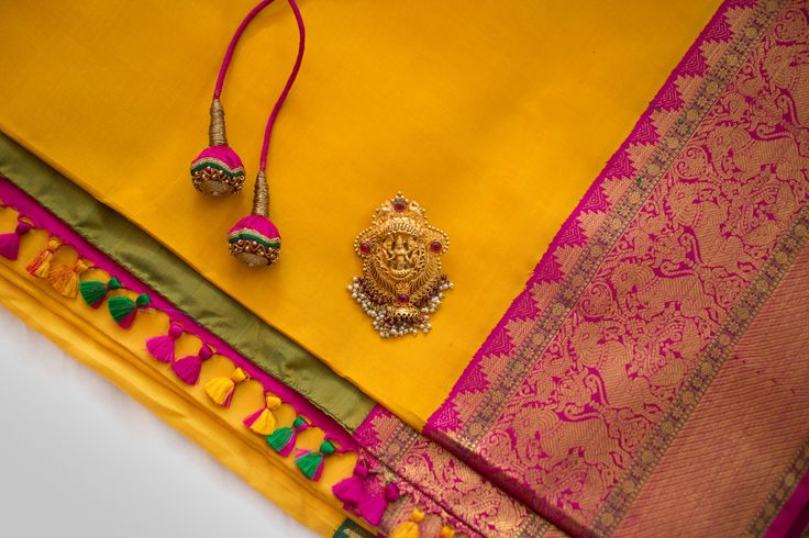 Indian Wedding jewellery . Kanjeevaram Saree Silk saree  details bangalore South Indian bride. Gold Indian bridal jewelry.Temple jewelry. Jhumkis. Yellow and pink silk kanchipuram sari.  Tamil bride. Telugu bride. Kannada bride. Hindu bride. Malayalee bride.Kerala bride.South Indian wedding.