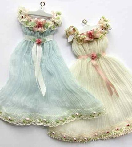 Vintage dresses ~*~ could be made with small scraps of vintage fabric also, as a page embellishment or framed photograph (i.e. a scrap of a childs dress or an old handkerchief)