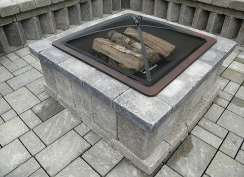 This fancier outdoor fire pit uses a fire insert with a screen, which is particularly nice to keep flying soot and sparks contained. Note however, you are limited to the amount of wood and fire size.