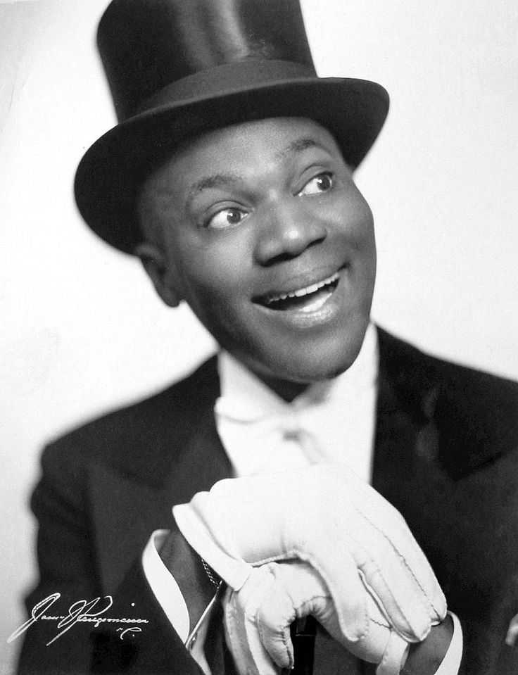 """Bill """"Bojangles"""" ROBINSON (1878-1949) Bio * AFI Top Actor nominee > Active 1900-43 > Born Luther Robinson 25 May 1878 Virginia > Died 25 Nov 1949 (aged 71) New York, heart failure > Other: Dancer, Activist > Spouses: Lena Chase (1907-22 div); Fannie S. Clay (1922-43 div); Elaine Plaines (1944-49, his death). Despite earning over US$2 million during his life, Robinson died penniless. His funeral was arranged and paid for by longtime friend TV host Ed Sullivan. Photo: 1942"""