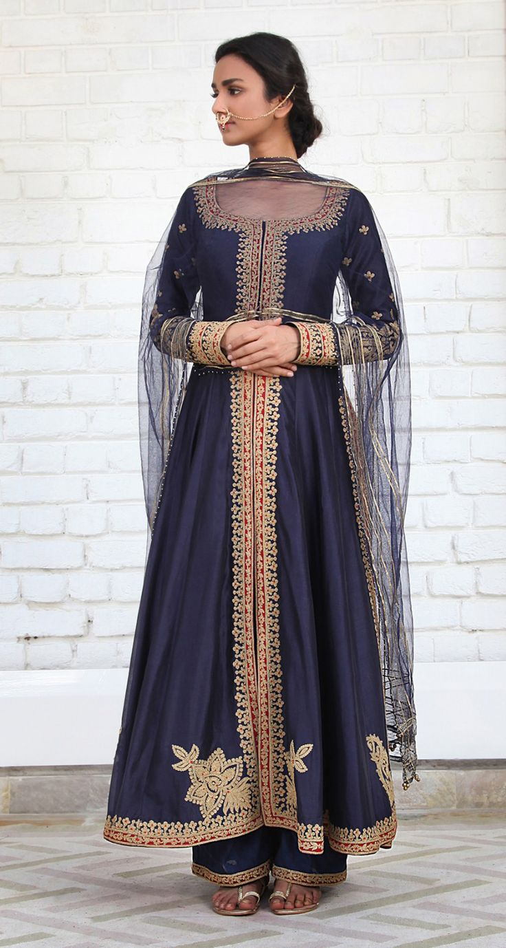 Rimple & Harpreet Narula. Navy Blue Chanderi silk  kalidar featuring delicate tilla-dori embroidery; paired with a soft tulle dupatta and farshi pants.