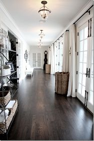 Dark hardwood floors and white walls in this hallway!