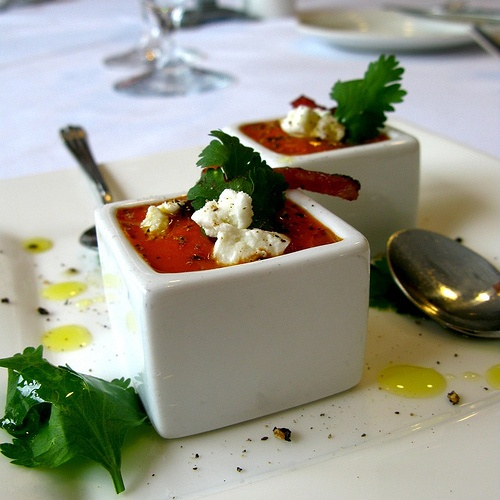 Chilled carrot paprika soup with goat cheese, pancetta and cilantro