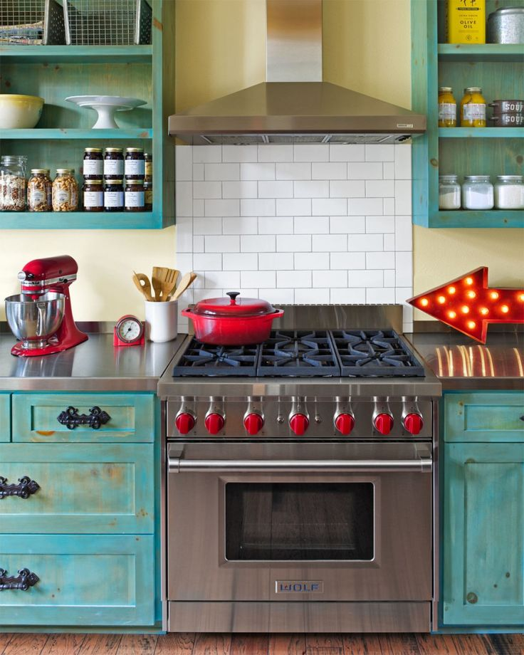 Country Kitchen Design With Blue Wooden Kitchen Island Using Steel Countertop Plus White Tiled Backsplash And Cooker Hood Above Gas Stove, Awesome Retro Style Kitchens Design : Kitchen