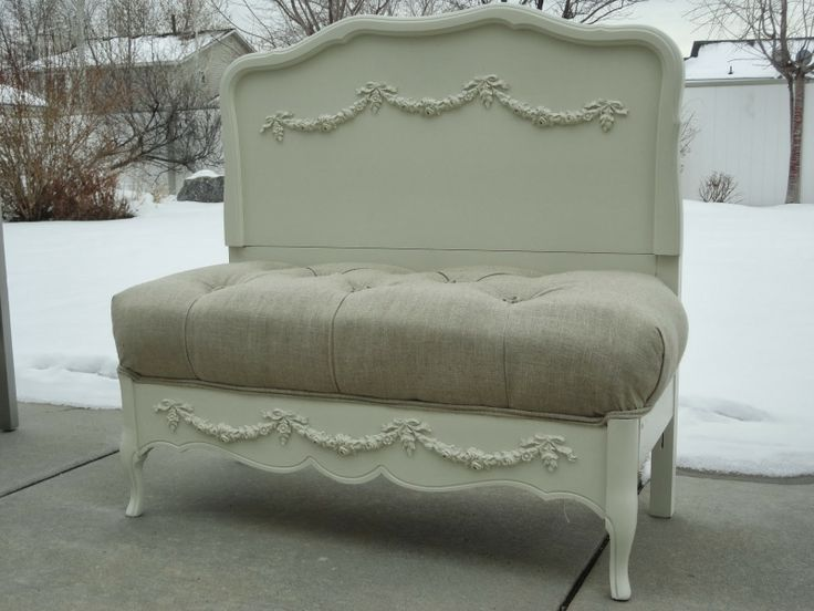 stunning setteebench made from a twin bed wood was refinished in soft white and has swag appliques on the headboard and footboard