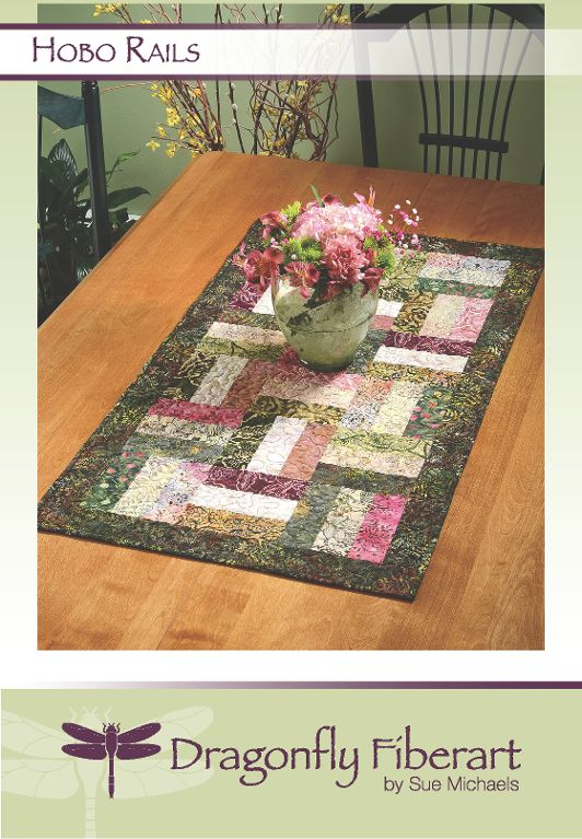 Looking for your next project? You're going to love Hobo Rails Table Runner E-pattern by designer Sue Michaels.