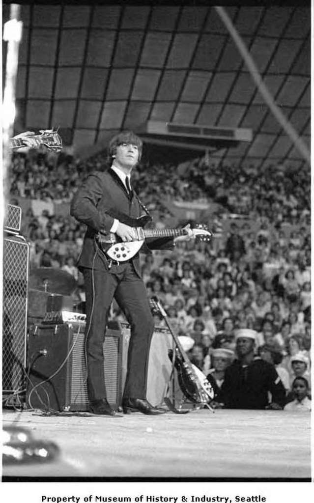 When the Beatles performed at the Seattle Center Coliseum in August 1964, nineteen-year-old photographer Timothy Eagan had an enviable view of the group from the edge of the stage. This vantage point gave Eagan the opportunity to photograph the four lads at relatively close range, as in this shot of Beatles founding member John Lennon. Eagan shot three rolls of film that night, practicing the photography which would become his professional career in Seattle and, later, New York City . In…