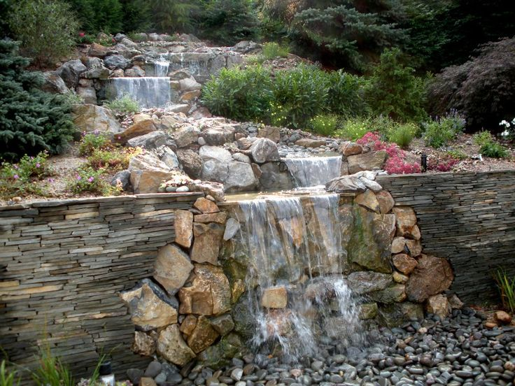 An 18 Foot Waterfall Was Created Out Of Moss Rock While Stacked Bluestone  Retaining Walls Hold
