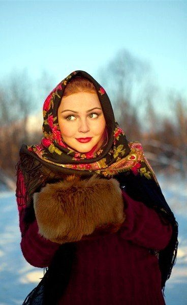 A pretty girl wearing a Russian Pavlovsky Posad shawl and a muff. #Russian #shawl #Russia: