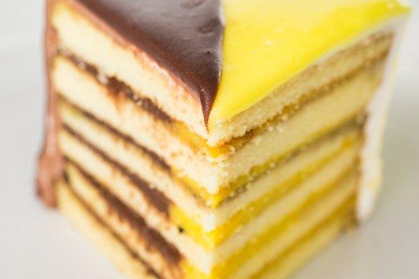 The ORINGINAL Doberge Cake half chocolate half lemon! Great for EVERY occasion.... birthday coming up?? Joe Gambino's Bakery New Orleans, Baton Rouge, Lafayette