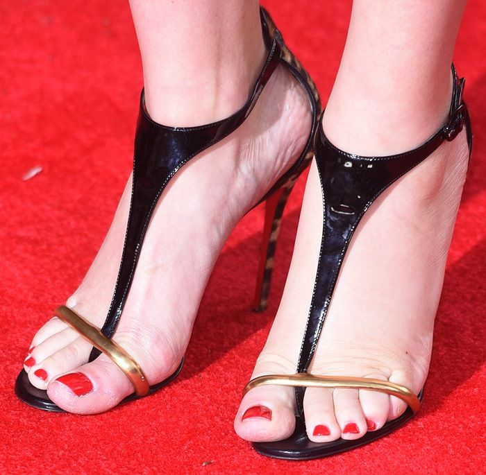 "Kate Winslet Puts Cleavage on Display in Christian Louboutin ""Athena Alta"" Sandals..... To not have your toes overhang like Ms Winslet see a video on utube on 'How to make high heels comfortable - you tube '   and to see a person do  hopscotch in high heels go to    ""   https://www.youtube.com/watch?v=OwGBW17fdxU   """