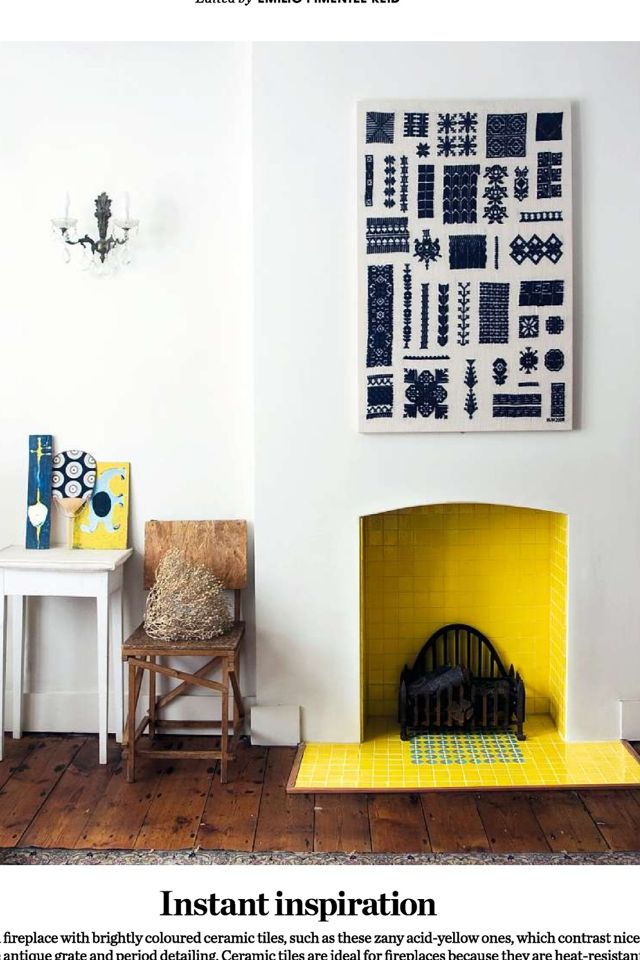 Yellow Tiles In Restored Fireplace With Wood Floor