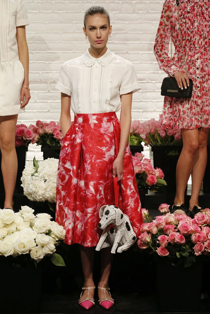 """Kate Spade, The Brand: Kate Spade New York is a brand inspired by colour. Branding with the slogan """"Live Colourfully"""", their image is easily understandable. Designer Deborah Lloyd literally set the mood for the collection's inspiration by introducing thousands of flowers into the runway space."""