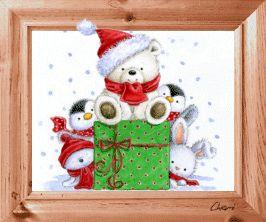 gif animé fetes de noel un ourson blanc avec bonnet et écharpe assis sur un énorme paquet cadeau derrière lequel se cachent des pingouins, un ourson et un lapin