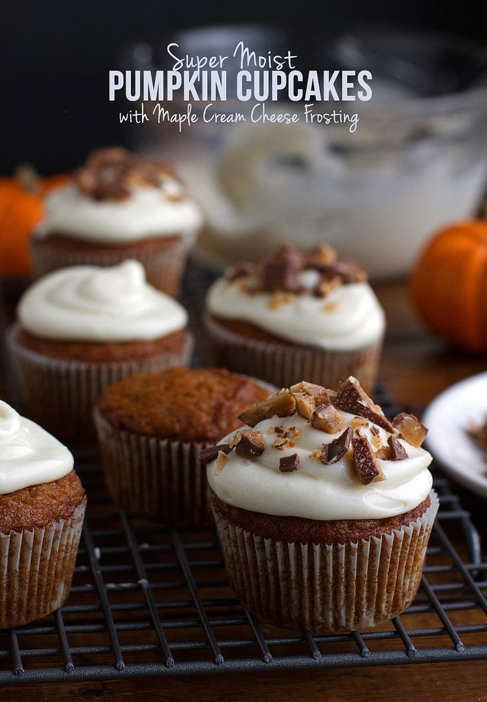 The best, most moist pumpkin cupcakes you'll ever have! Topped with maple cream cheese frosting #pumpkin #fallrecipes #cupcakes