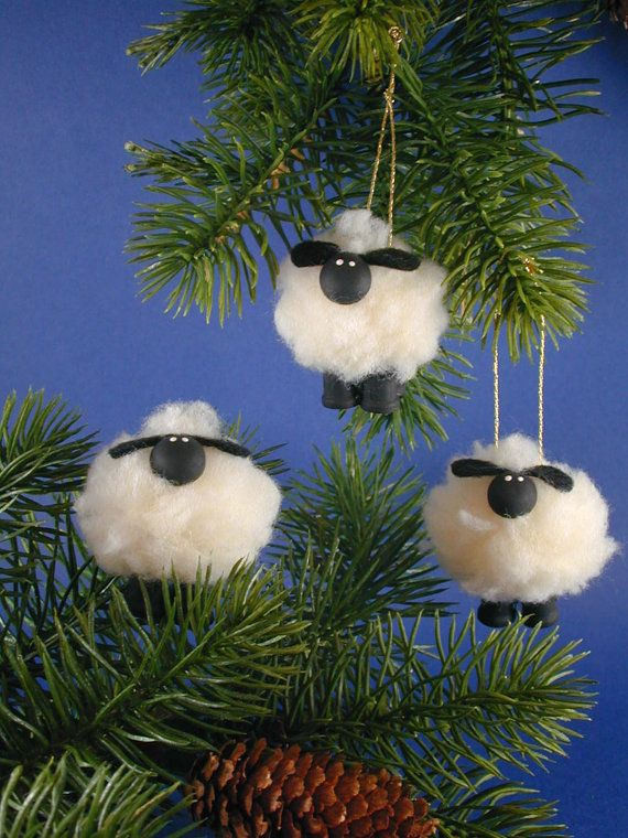 Lamb/Sheep Ornament by clotheslinecuties on Etsy, $3.50 These lambs can't jump over a fence in your sleep but they can decorate your Christmas tree. Body is made of faux sheepskin fabric, legs are spools and the face is a furniture button framed by felt ears. String for hanging can be easily removed if you wish to have the sheep standing on a shelf.