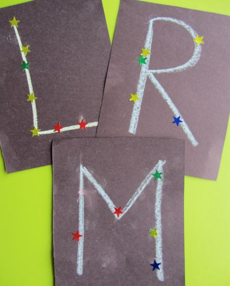 letter constelations -- made into a pennant spelling the wee one's name-- made by mommy and me