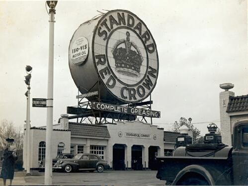 """Red Crown Service Station (Skinker and Clayton Roads) [Charlie Mudd Standard Service """"The Station With the Big Sign""""]. 981 South Skinker Boulevard. 