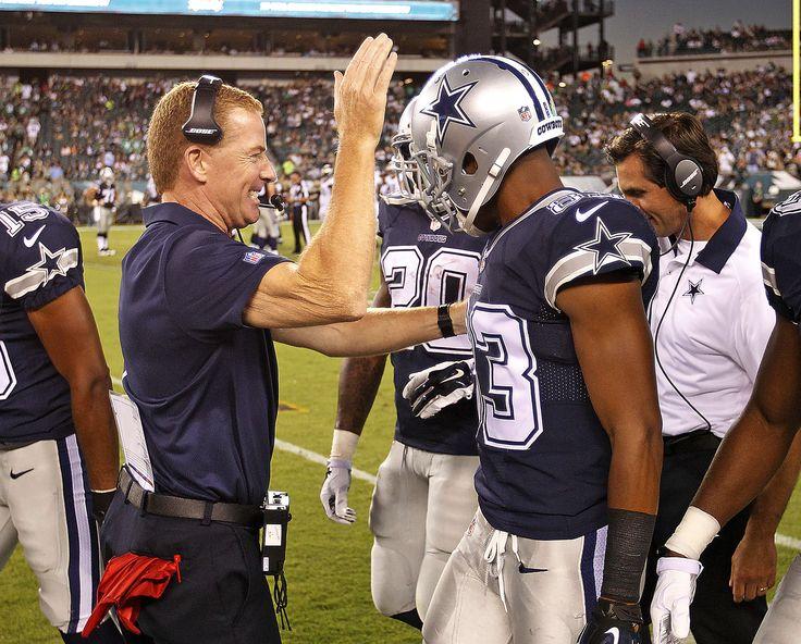 Dallas Cowboys head coach Jason Garrett (left