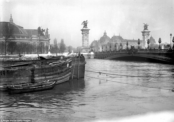 A view of the Alexandre III bridge in the centre of Paris shows how dangerously high the w...