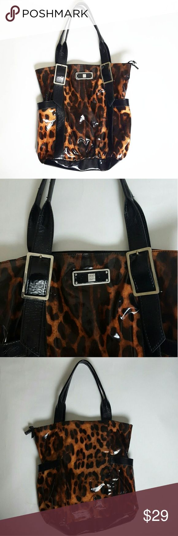 New York & Company Animal Print Bag Wet look animal print tote bag Features 1 deep pocket on each side of bag  Inside features 1 zipper pocket Interior shows minor signs of wear, in great condition!. Any questions? Feel free to ask. Happy Poshing! New York & Company Bags