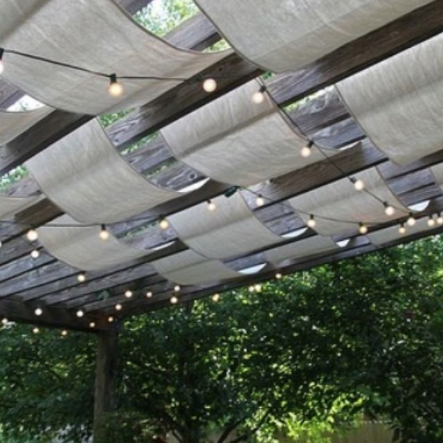 Patio cover fabric lights. Fabric is a good idea to soften patio and make it more cozy/ less industrial.