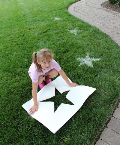 Stencil the yard using flour!! How fun is that?!?!