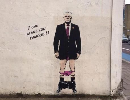 a piece of artwork similar to the work of banksy featuring shamed pr guru max clifford has appeared on a wall in battersea in london