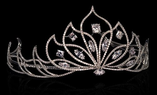 Leviev's petal-motif diamond tiara contains five cushion-cut and six marquis-shaped diamonds totaling 13.76 carats. They're surrounded by white diamond pavé weighing 27.92 carats, all set in platinum