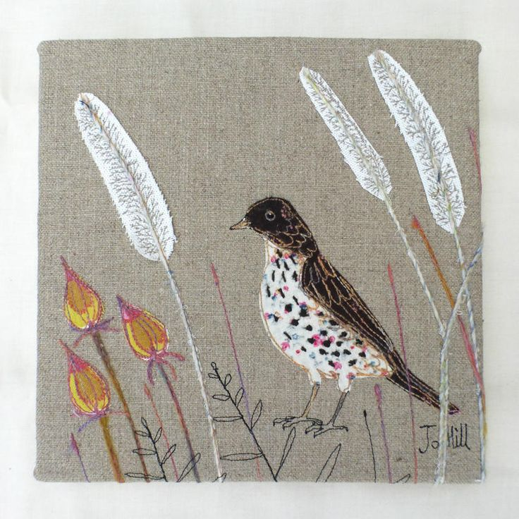 """Please note, this wall hanging is currently on display at the Saltbox Gallery, York and I will make new ones to order.A mistle thrush stitched with its distinctive markings, standing amongst the reeds grasses. Add a touch of colour to your walls!I have designed and stitched this and it includes appliqué detail for the bird and grasses, as well as lots of hand-stitched detail.This wall hanging measures 9"""" x 9"""" and comes ready to hang on your wall.Please note, this item will be made ..."""