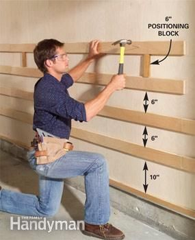 Space and nail plywood rails to garage wall for custom adjustable garage storage system-see multiple pins for additional photos