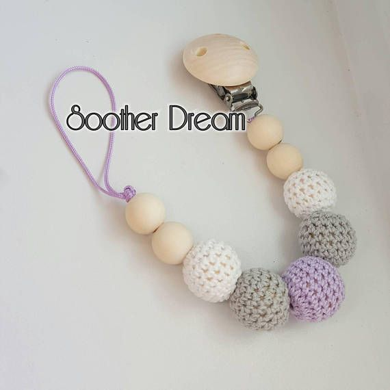 Check out this item in my Etsy shop https://www.etsy.com/ca/listing/291262837/soother-chain-pacifier-holder-dummy-clip