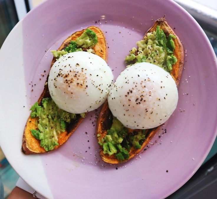 Sweet potato toast Cut 1/4 inch slices of sweet potato Toast in toaster until brown with a few dark patches  Top with avocado and poached egg