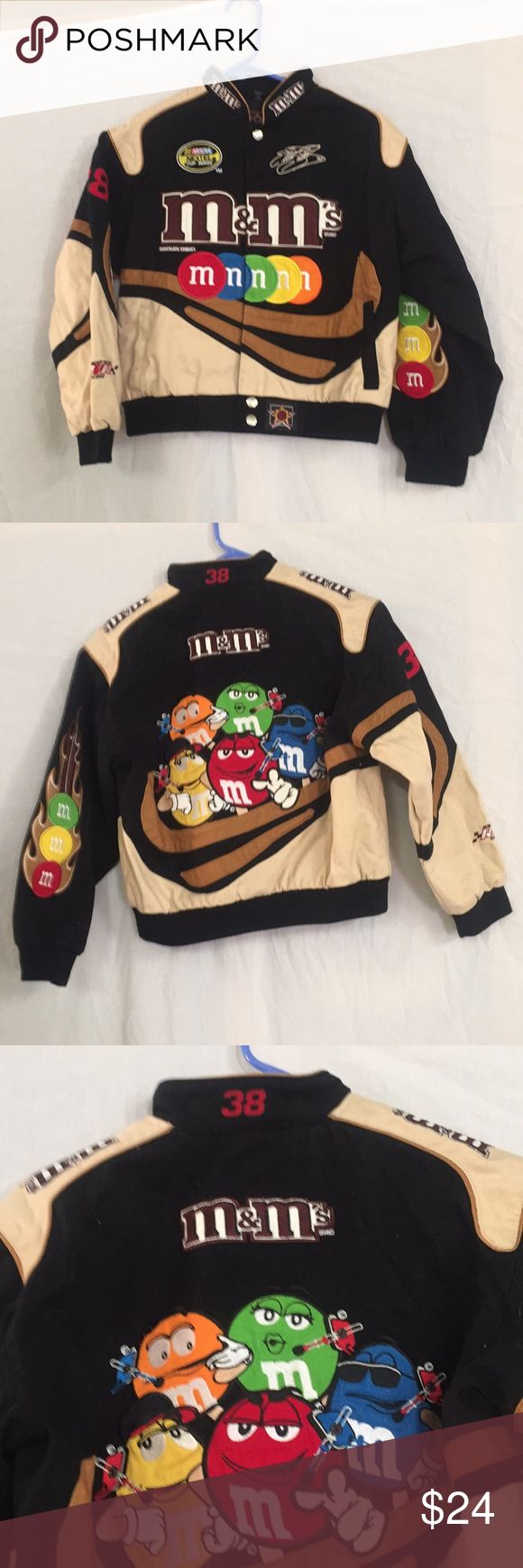 Child's M&M NASCAR Jacket, Size Large Child's M&M nascar Jacket byJH Design. It is a size large. Chest measures 36 inches and collar to hem is 20 inches. It has number 38 and has a signature on front. It is in good shape. Good jacket. JH Design Jackets & Coats