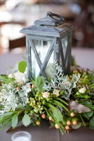 Vintage-Lantern-Centerpiece - maybe with frosting or some sort of sparkle. I like how natural and antique it looks.